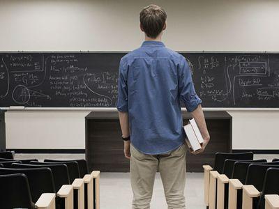 Standing in empty classroom
