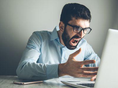 angry man using computer