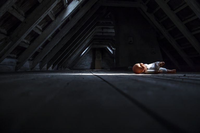 Doll laying in attic
