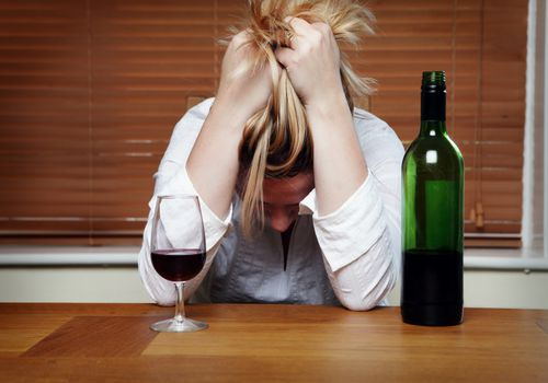 Depressed Woman with Red Wine