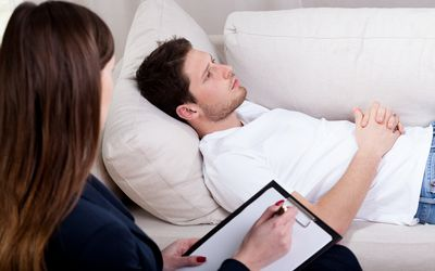 Therapist working with patient on hypnosis