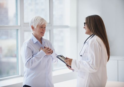 Older woman talking to doctor