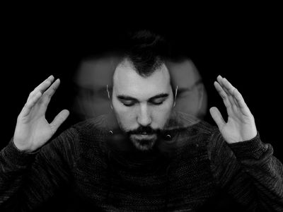 Digitally Generated Image Of Man Shaking Head Against Black Background
