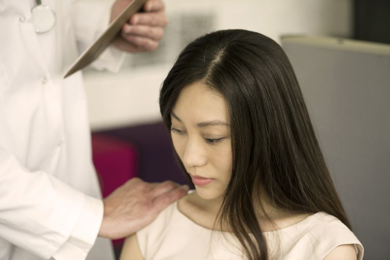 Woman receiving bad news from doctor, cropped