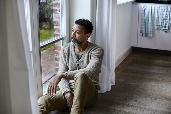 A man with depression gazing out of a window