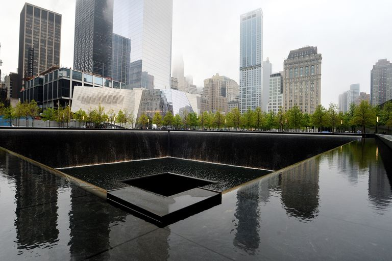 9/11 Memorial fountain with skyscrapers in background