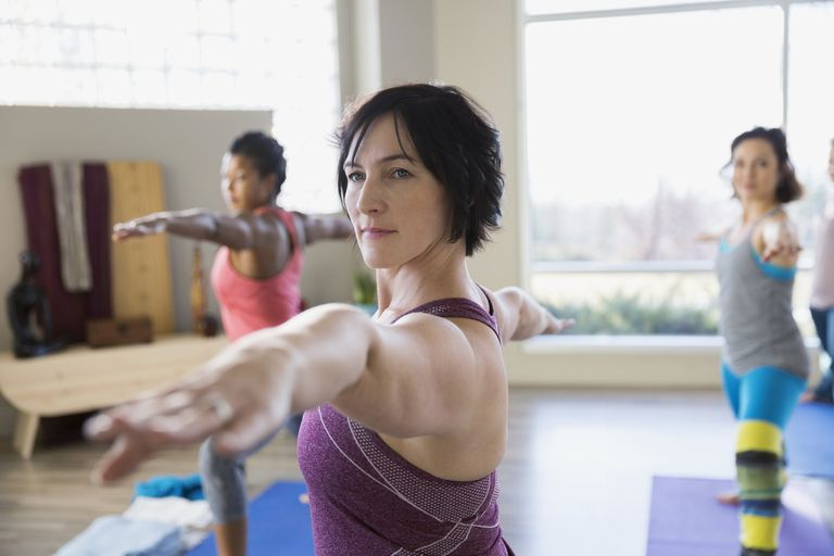 Woman participates in yoga class