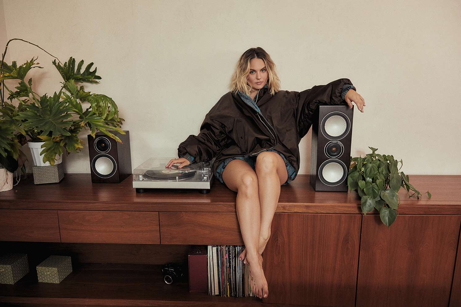 JoJo sitting on top of media cabinet next to record player