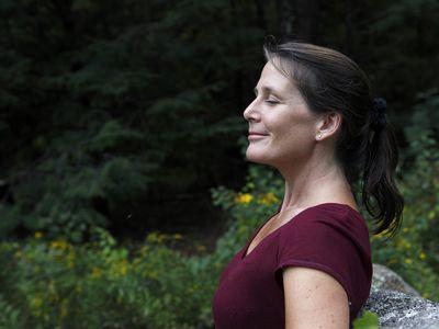 Woman breathing in fresh outdoor air