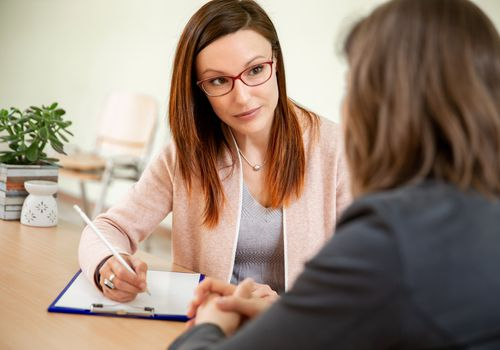 Woman talking to a mental health professional.
