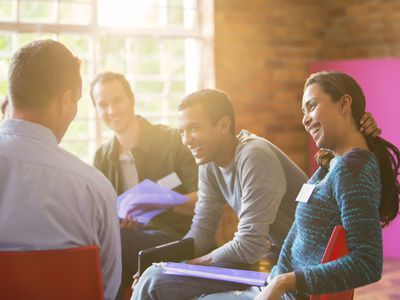 Smiling woman enjoying group therapy session