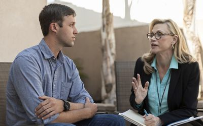 man talking with female therapist