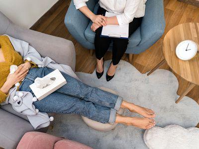 Woman psychologist talking to patien