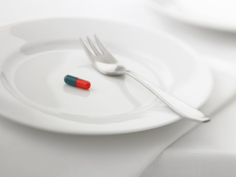 Close up of pill capsule on plate