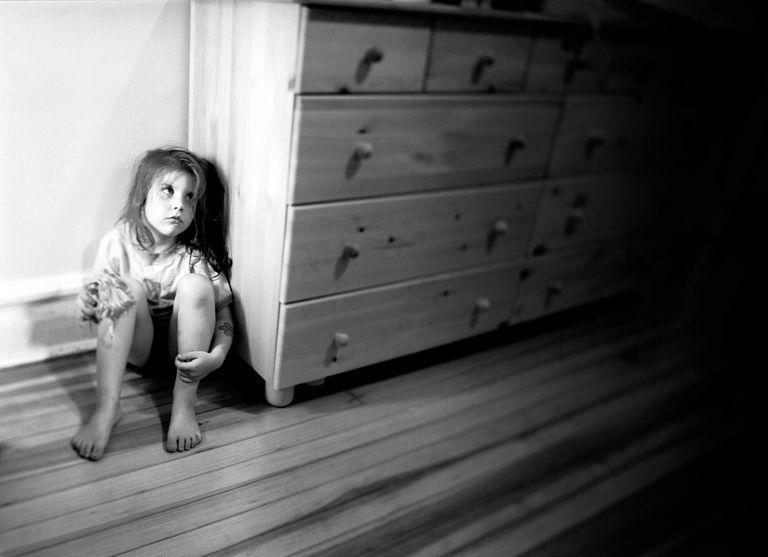 Girl Hiding in Corner