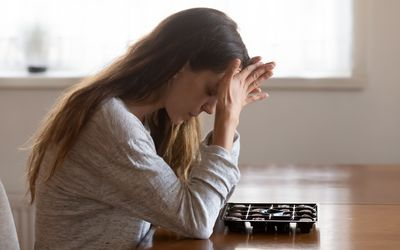 Young woman stress eating chocolates